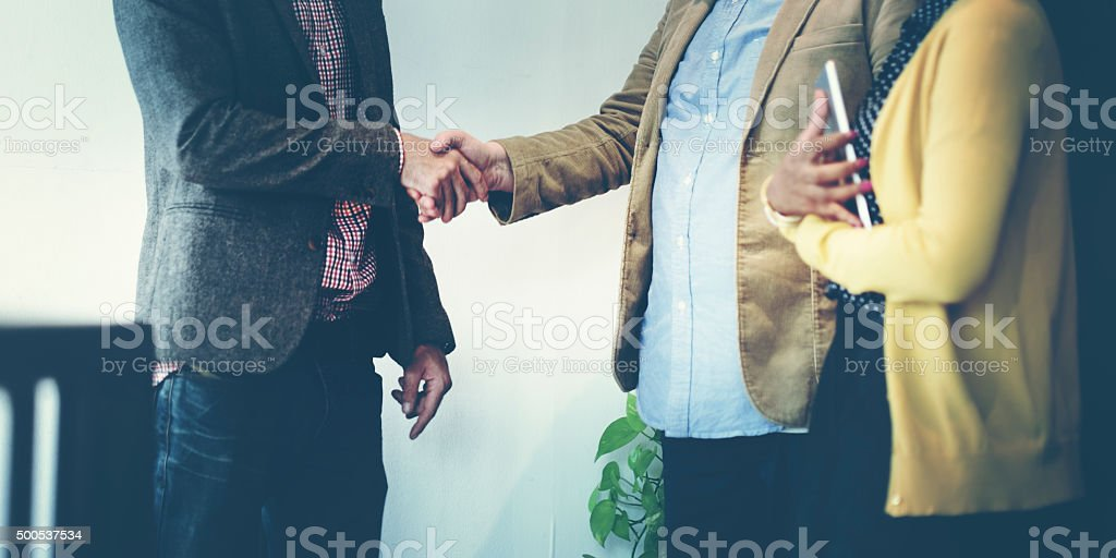 Business Team Partnership Greeting Handshake Concept stock photo
