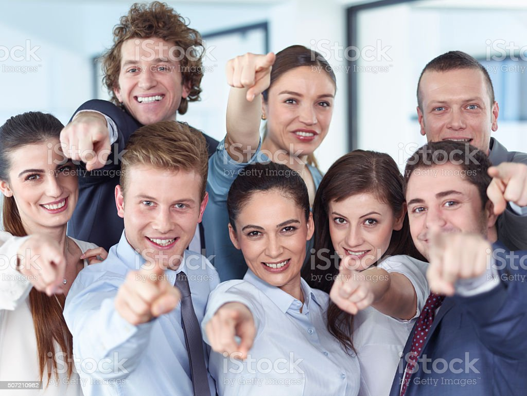 Business team pointing camera stock photo