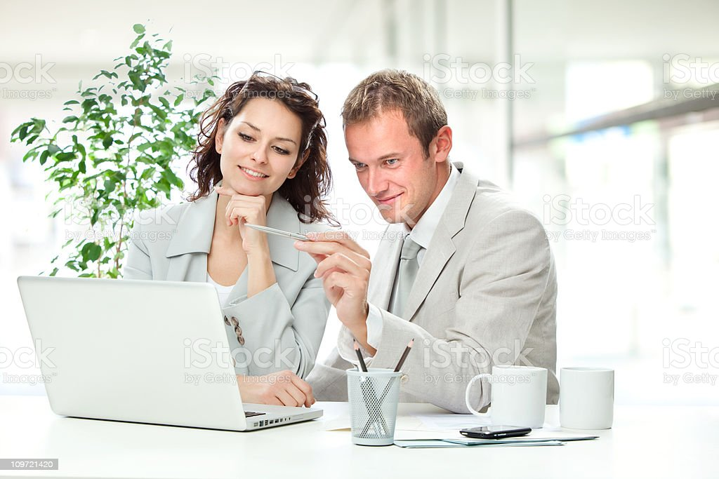 business team portrait at office with laptop royalty-free stock photo