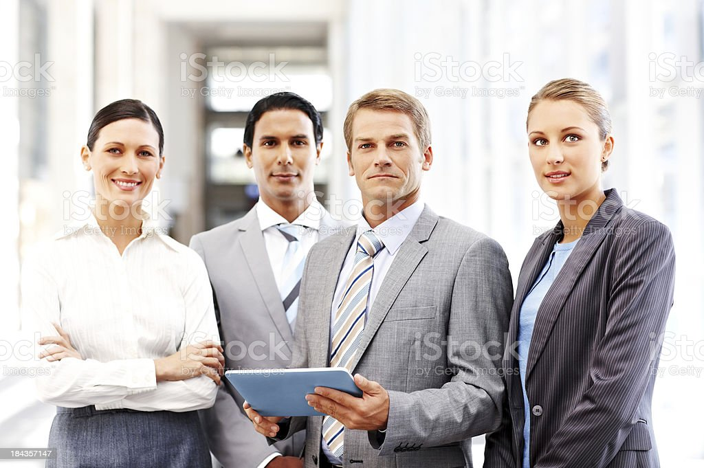 Business Team Posing With a Tablet Computer royalty-free stock photo