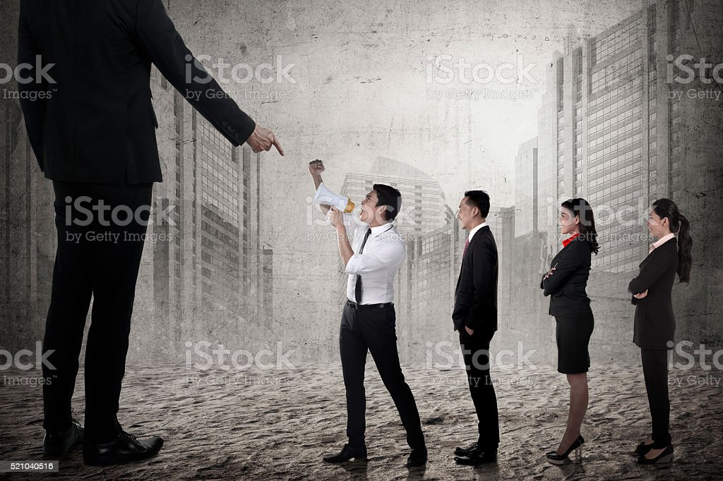 Business team protest to the boss using megaphone stock photo