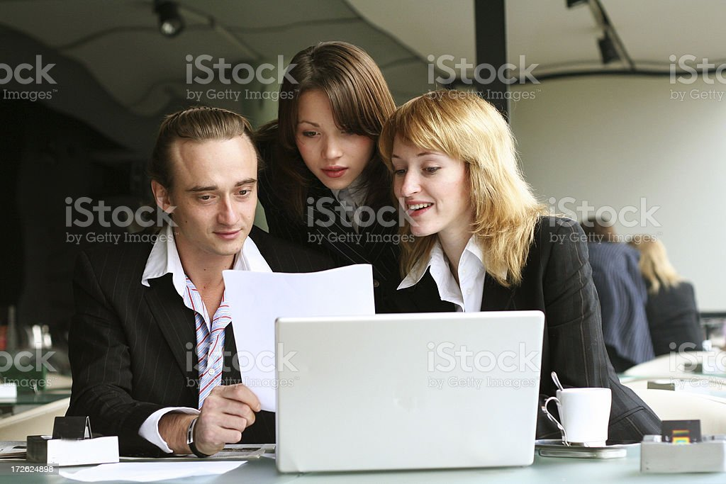 business team reading document royalty-free stock photo