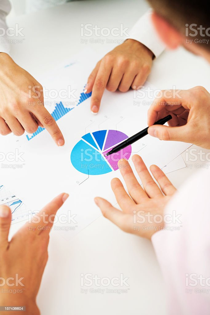 Business Team Reviewing Charts Together royalty-free stock photo