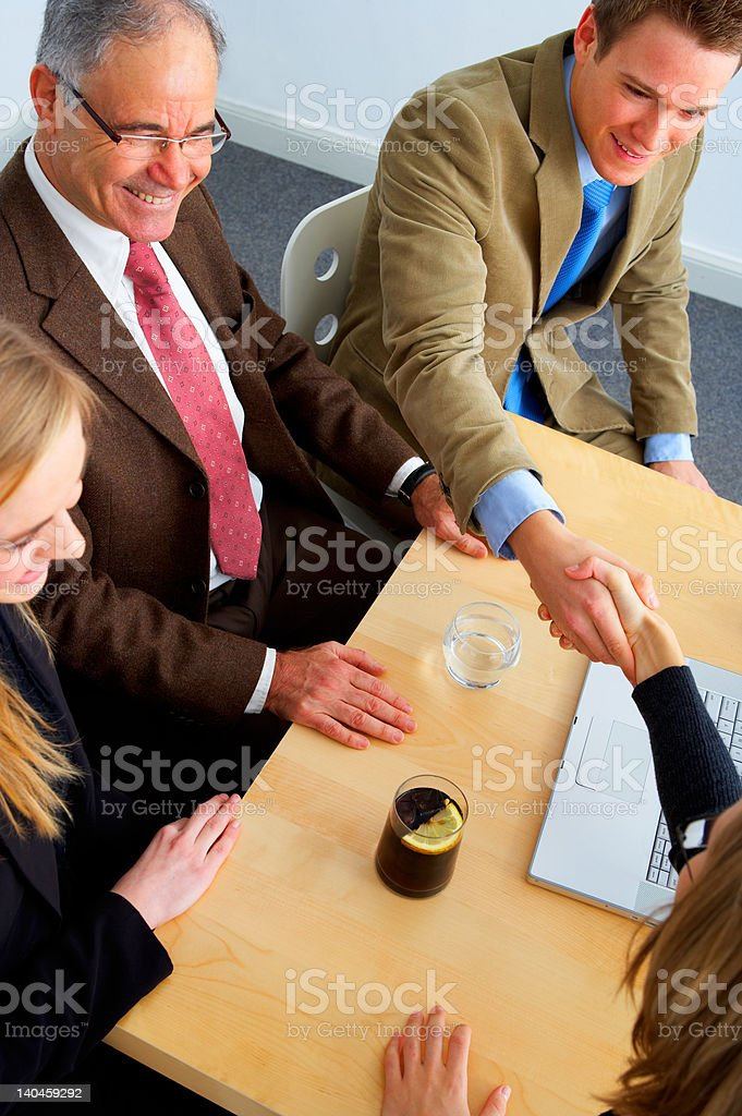 Business team shaking hands royalty-free stock photo