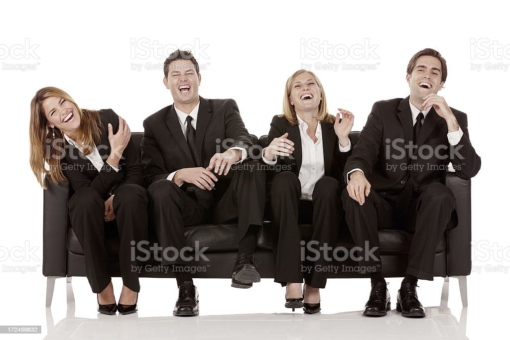 Business team sitting on a couch and laughing royalty-free stock photo