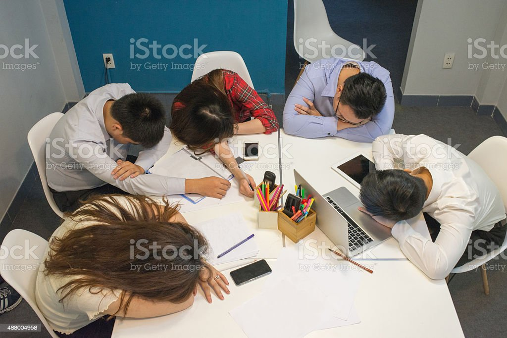 Business team sleeping and resting in the meeting room stock photo
