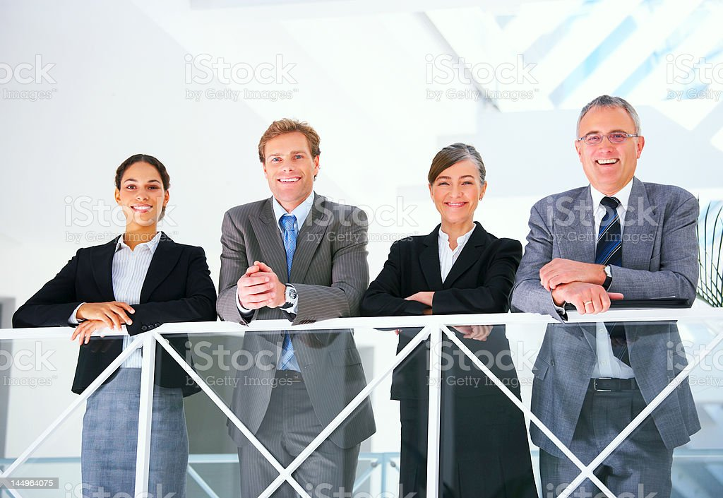 Business team smiling royalty-free stock photo