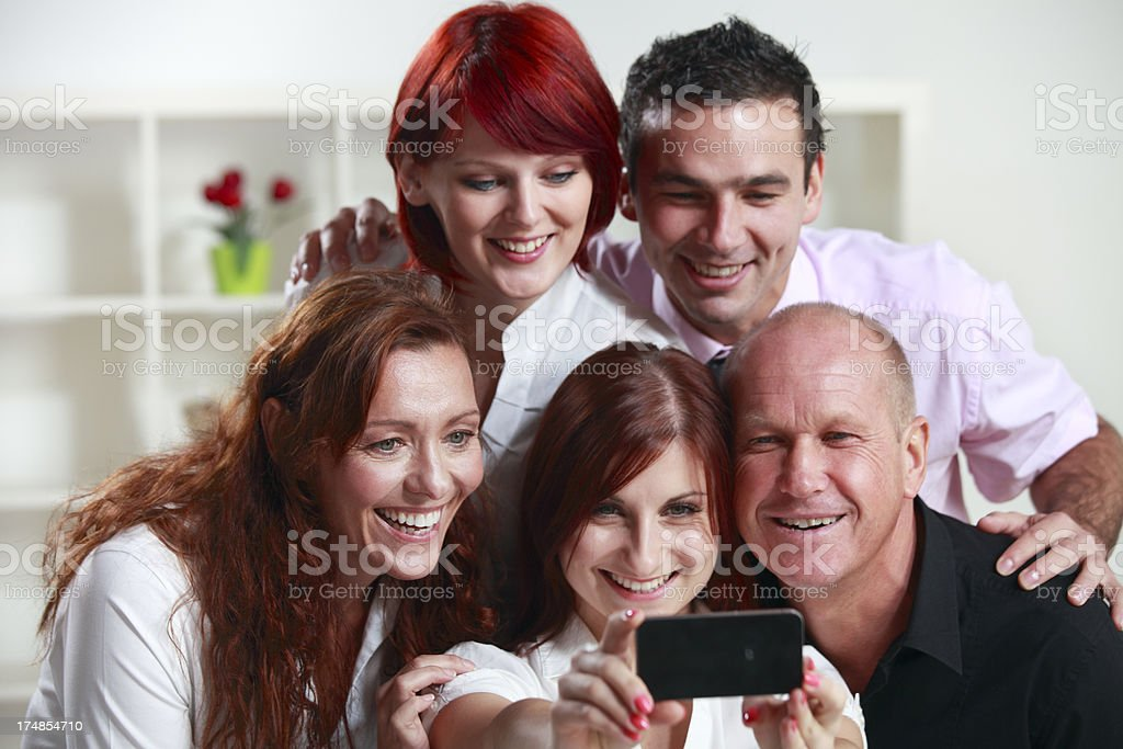 Business team taking a photo royalty-free stock photo
