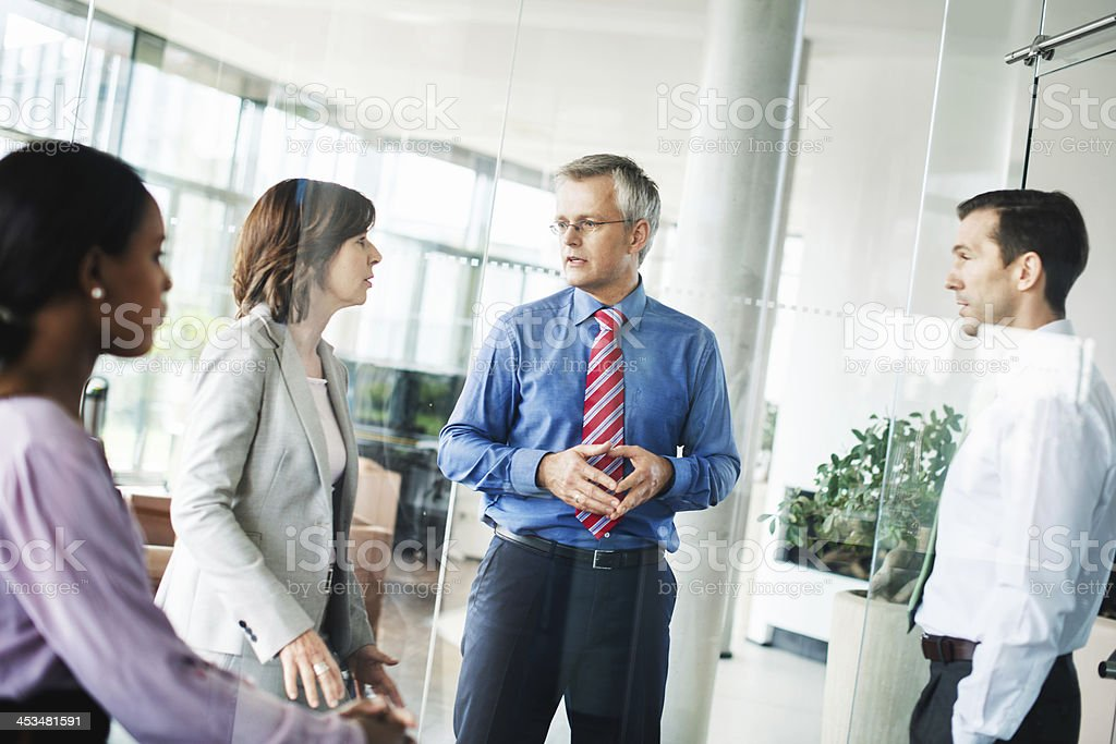 Business Team Talking in Modern Office Space royalty-free stock photo