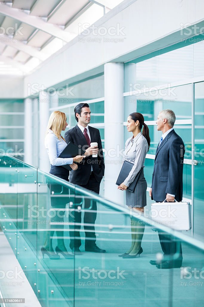 Business team talking in the office hallway royalty-free stock photo