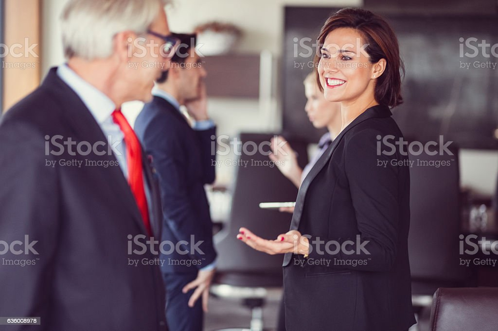 Business team talking in the office stock photo