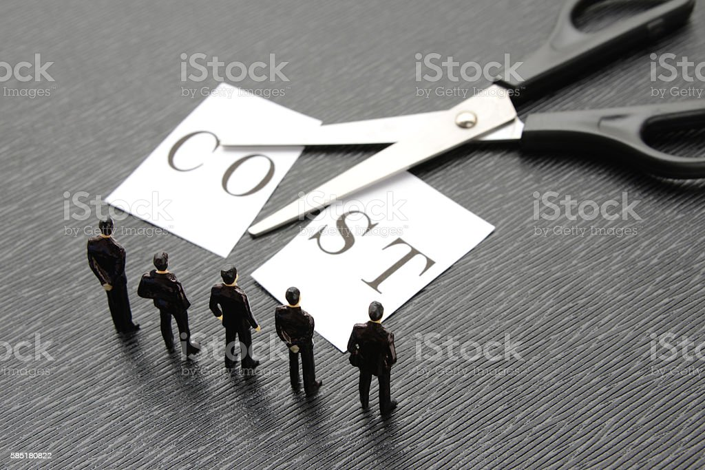 Business team thinking about cost cut stock photo