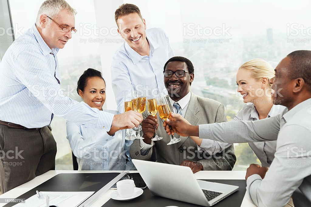 Business team toasting champagne flutes royalty-free stock photo