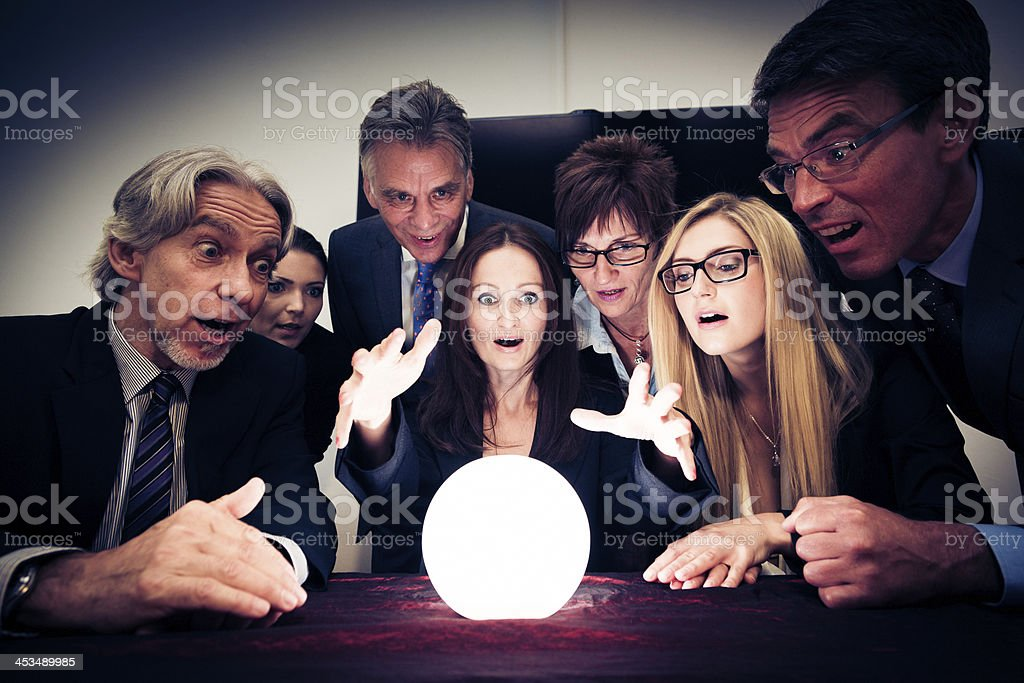 business team using a crystal ball to look into future stock photo