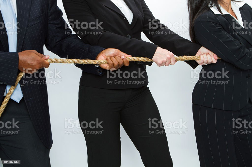 Business Team with a tug of war rope stock photo