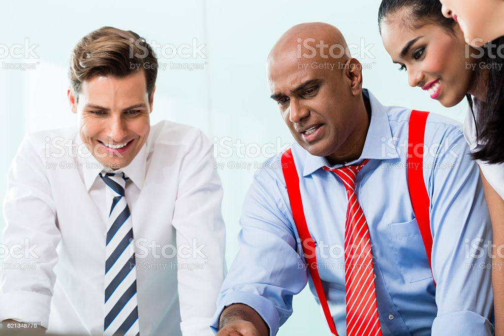 Business team with Indian CEO in meeting stock photo