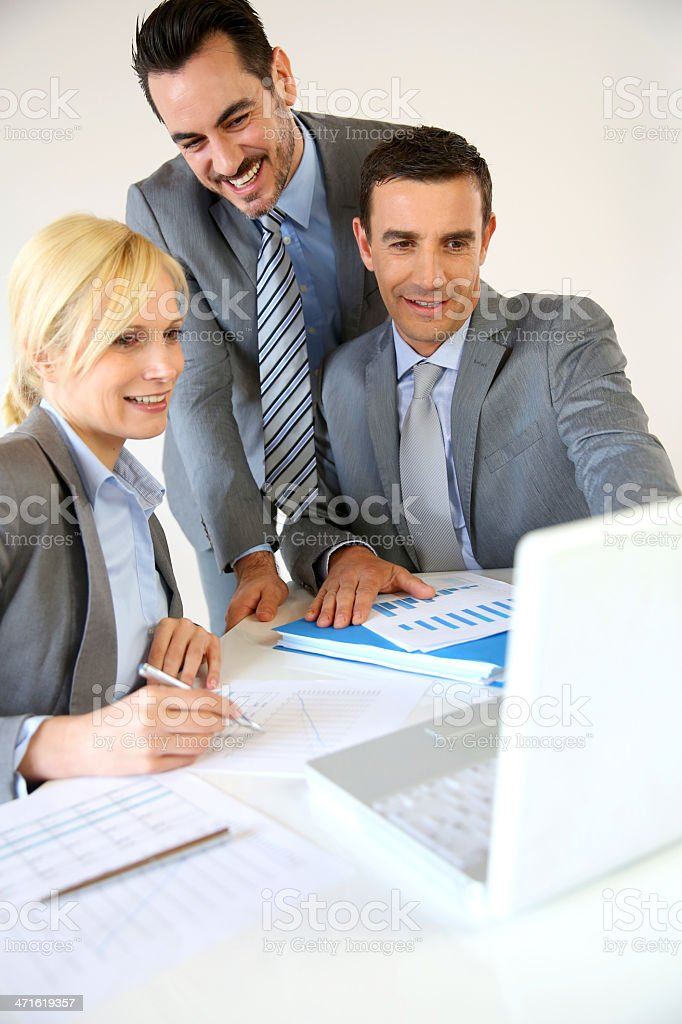 Business team working in front of laptop royalty-free stock photo