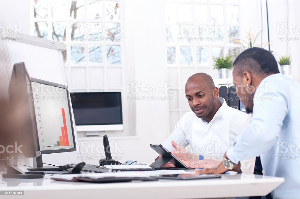 Business team working in the office stock photo