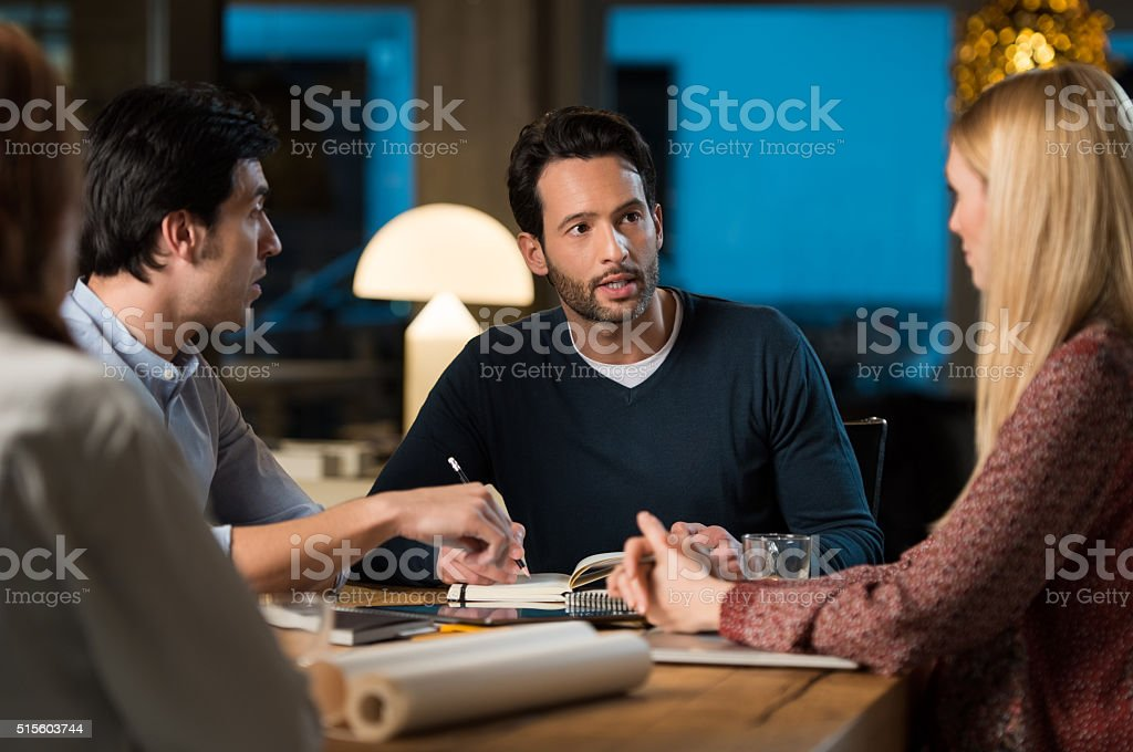 Business team working late stock photo