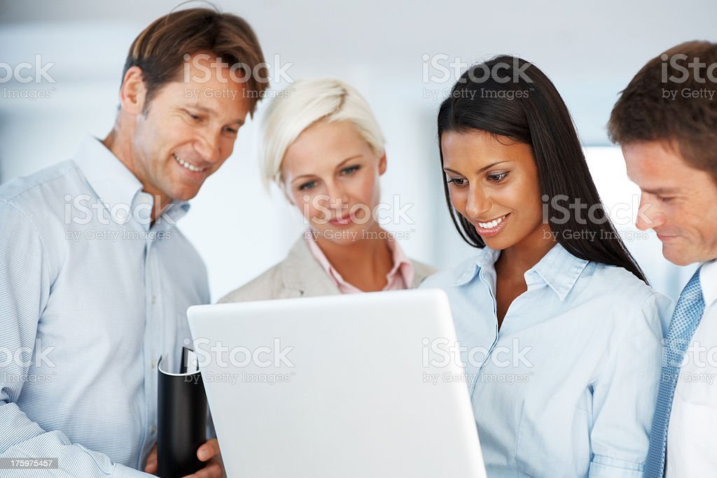 Business team working on laptop in office stock photo
