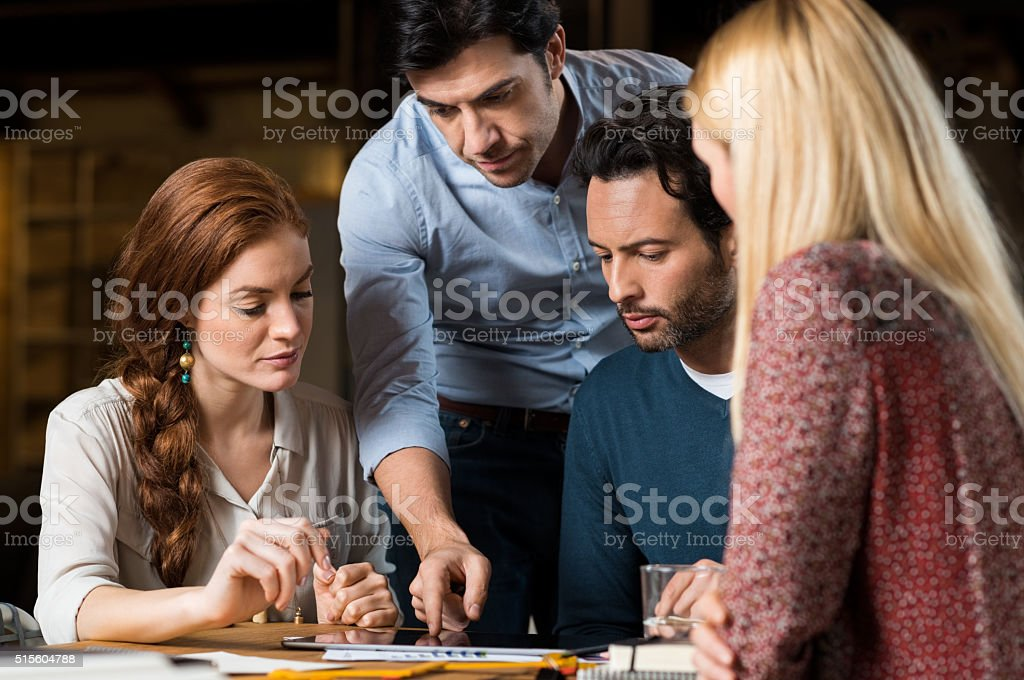 Business team working on laptop stock photo