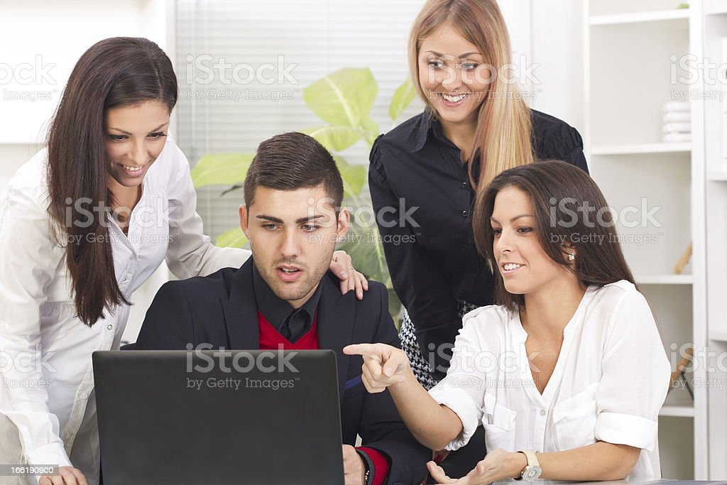 Business team working on their laptop together at office royalty-free stock photo
