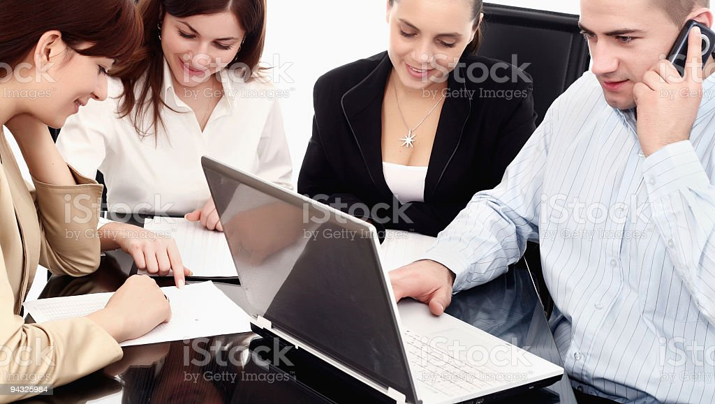 business team working over a laptop computer royalty-free stock photo