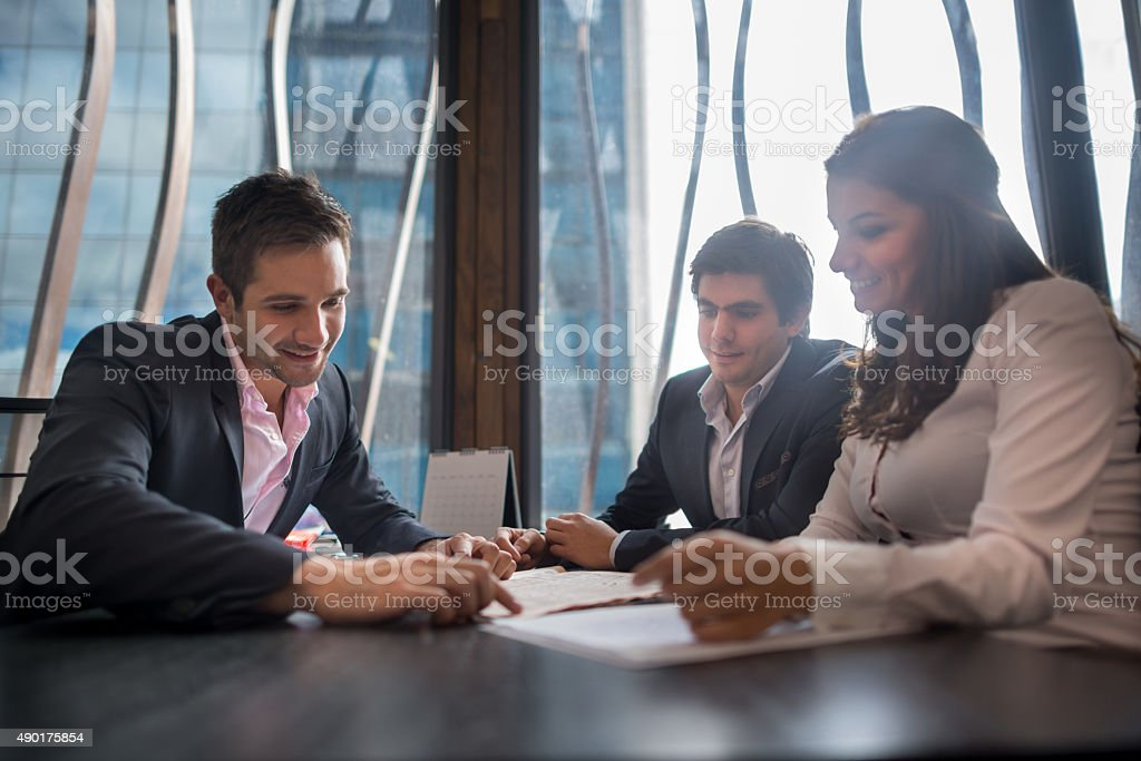 Business team working together at the office stock photo
