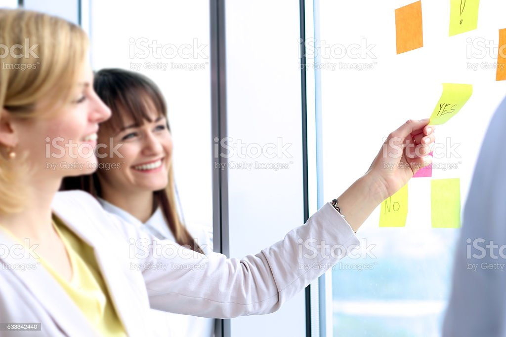 business team working  with   digital tablet and stickers in office stock photo