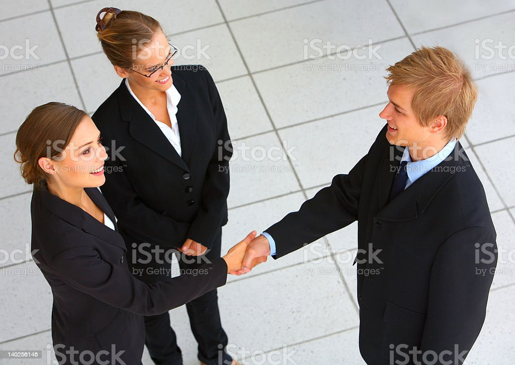 Business team wrapping up a meeting with handshake royalty-free stock photo