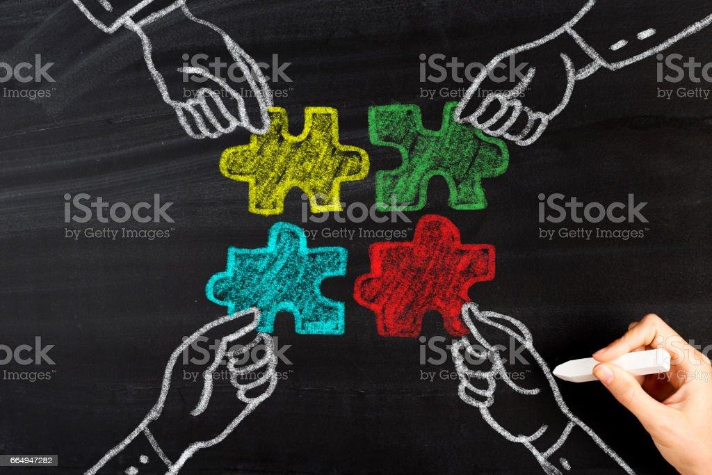 Business teamwork concept on chalkboard stock photo
