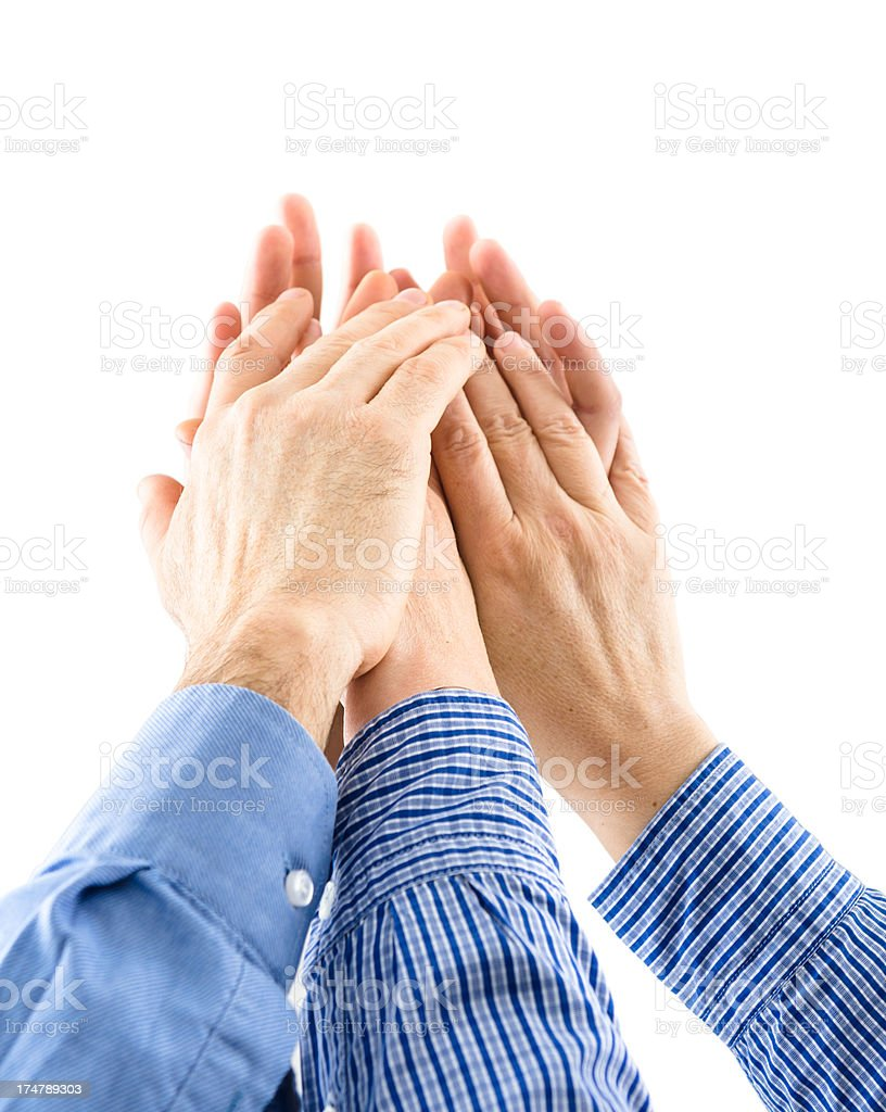 Business teamwork with a arm raised for success royalty-free stock photo