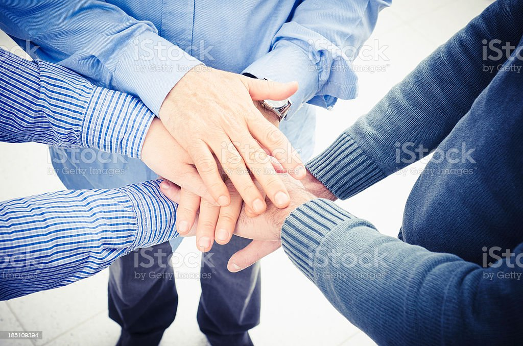 Business teamwork with a stack of hands royalty-free stock photo