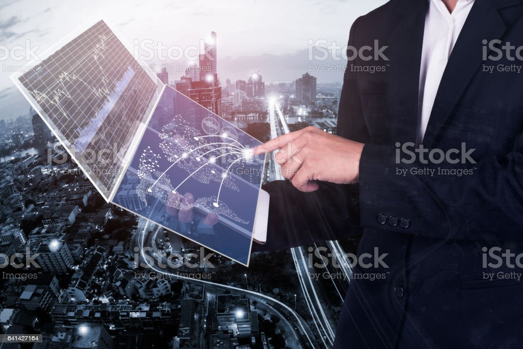 business technology concept,businessman working on tablet  with digital layer business  and media diagram stock photo