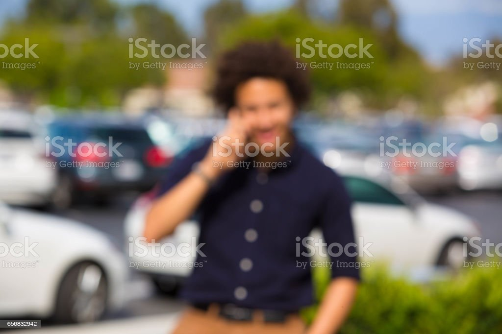 Business Teen Taking Work Call OUT OF FOCUS stock photo