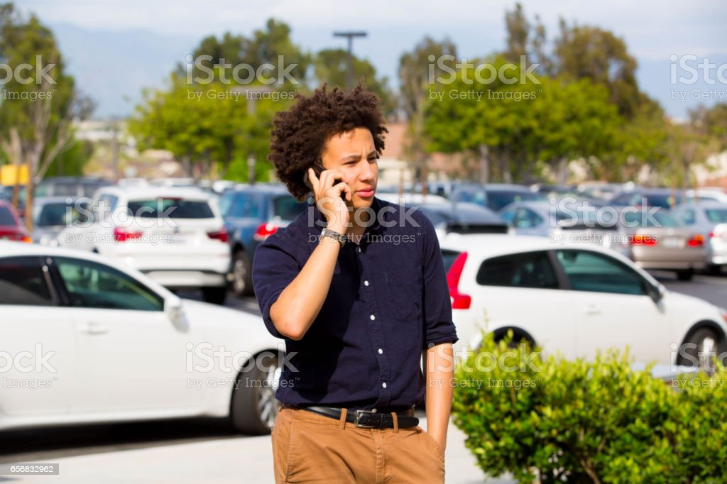 Business Teen Taking Work Call stock photo