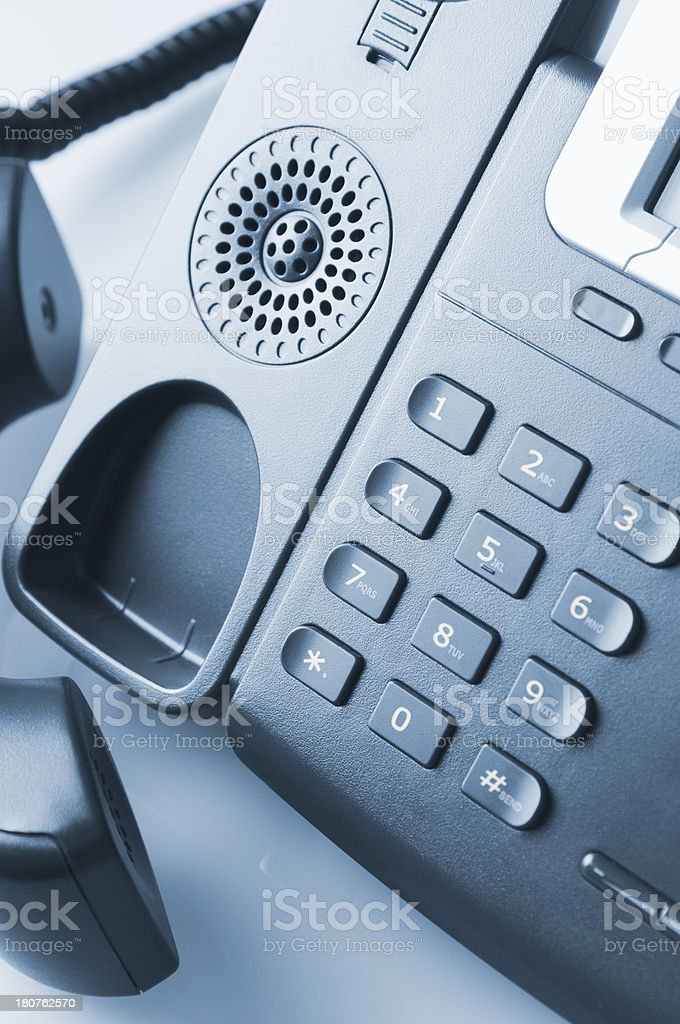Business telephone with receiver off the hook royalty-free stock photo