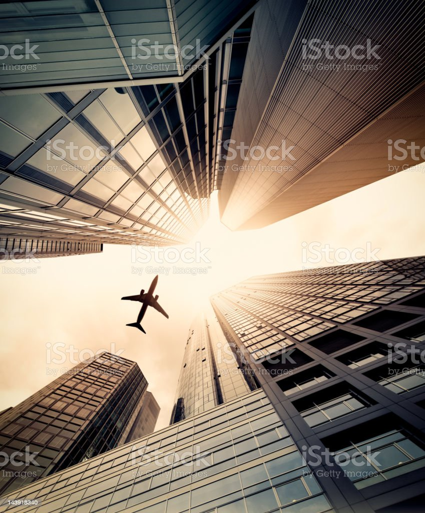 Business towers with a airplane silhouette stock photo