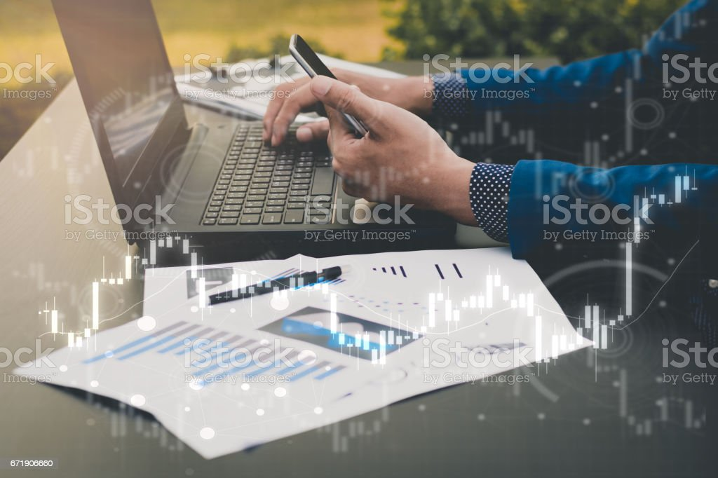 business trading concept : man trade stock and forex in notebook and analysis market stock photo
