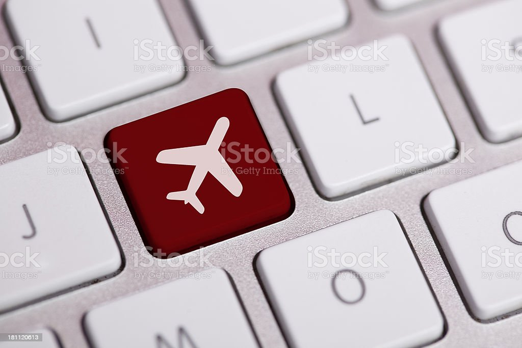 Business travel concept on a laptop keyboard stock photo
