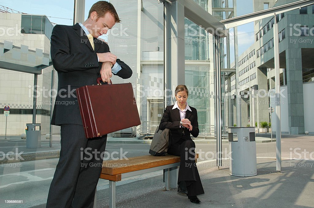 Business Travel: Waiting for the bus royalty-free stock photo