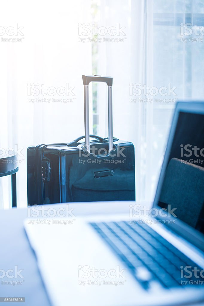 Business travel with laptop and luggage stock photo