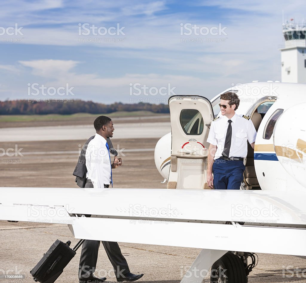 Business Traveler Boarding Private Jet royalty-free stock photo