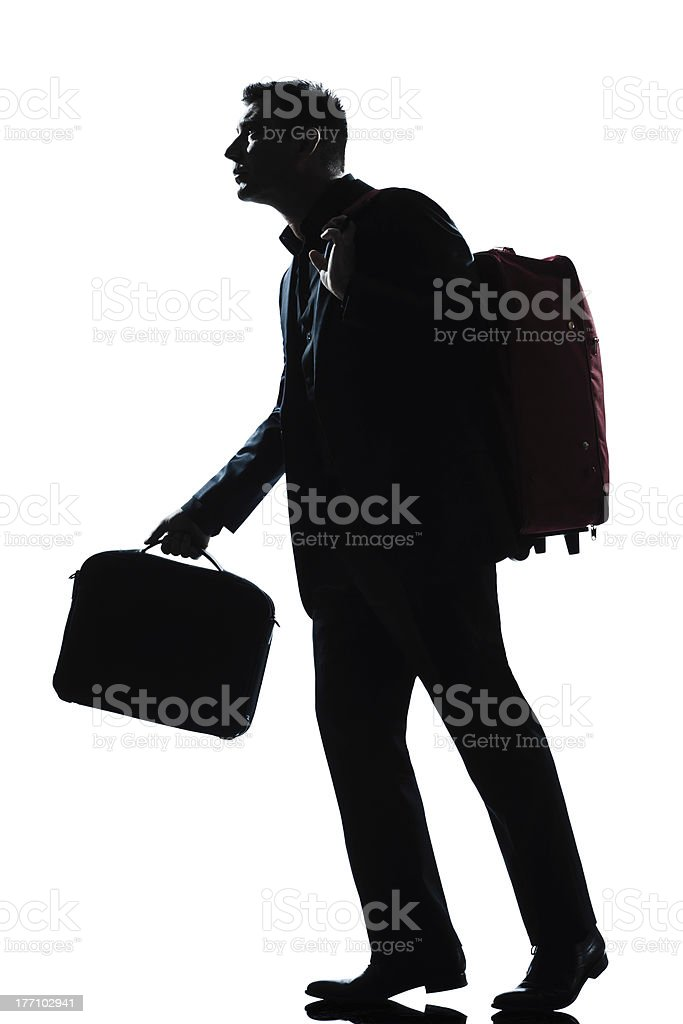 business traveler man walking with suitcase  on shoulders royalty-free stock photo
