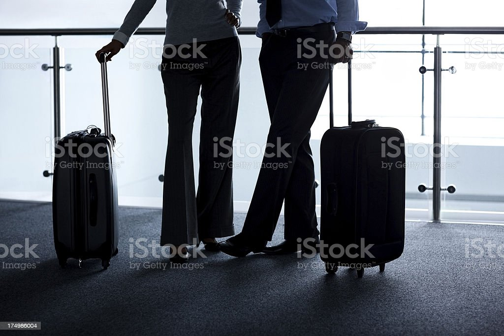 Business travelers silhouettes at airport royalty-free stock photo