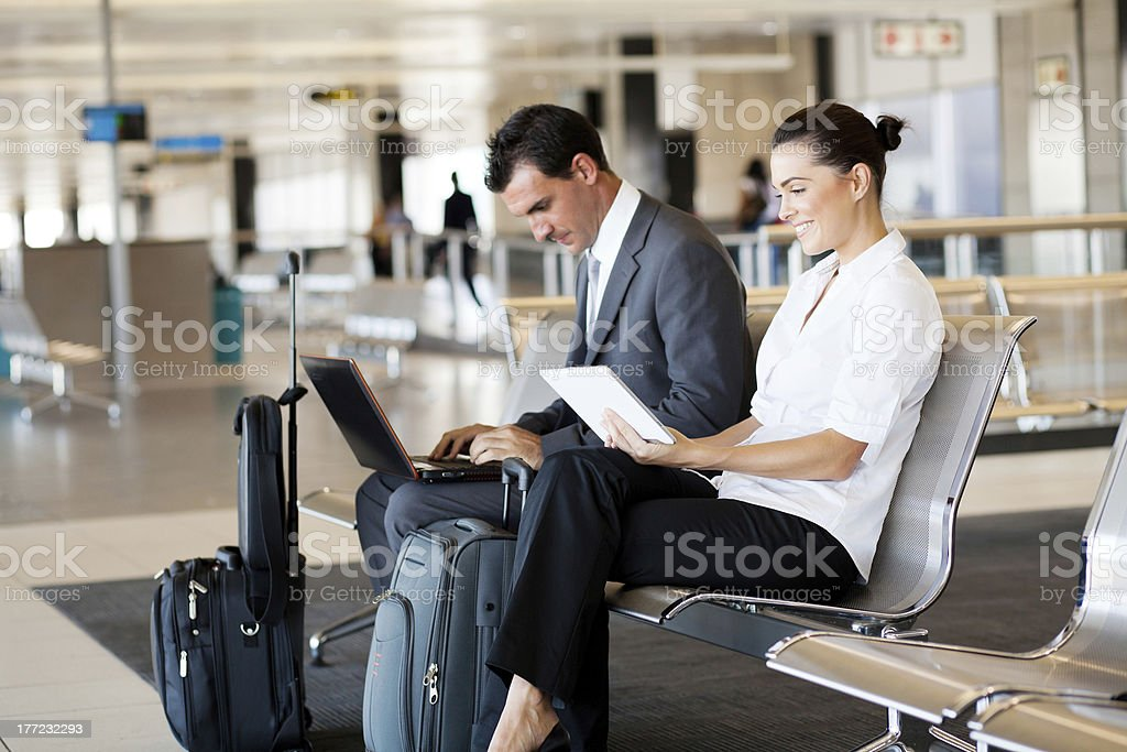 Business travelers waiting in airport stock photo