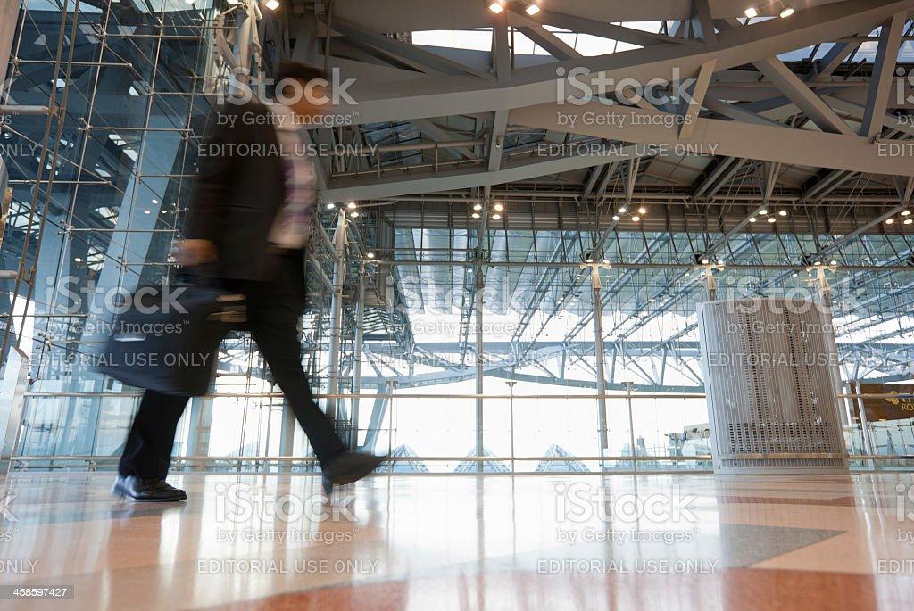 Business traveller passes through Suvarnabhumi Airport, Bangkok, Thailand. royalty-free stock photo