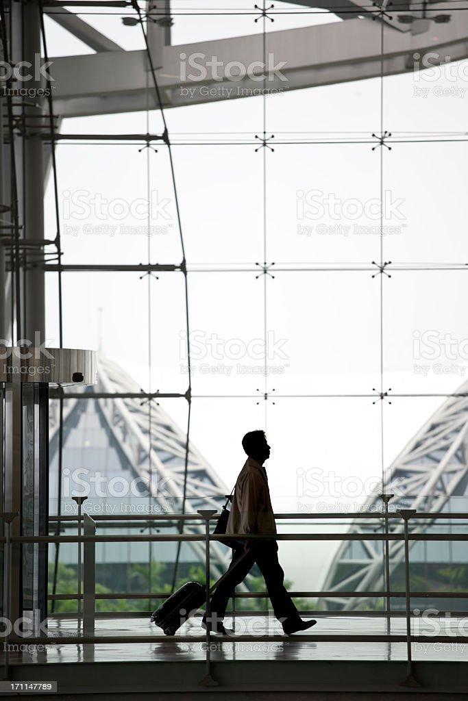 Business traveller passing through Suvarnabhumi Airport, Bangkok, Thailand. royalty-free stock photo