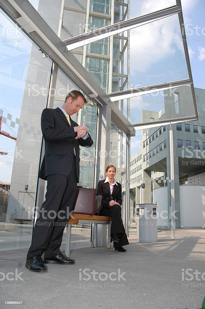 Business trip: waiting for the bus royalty-free stock photo