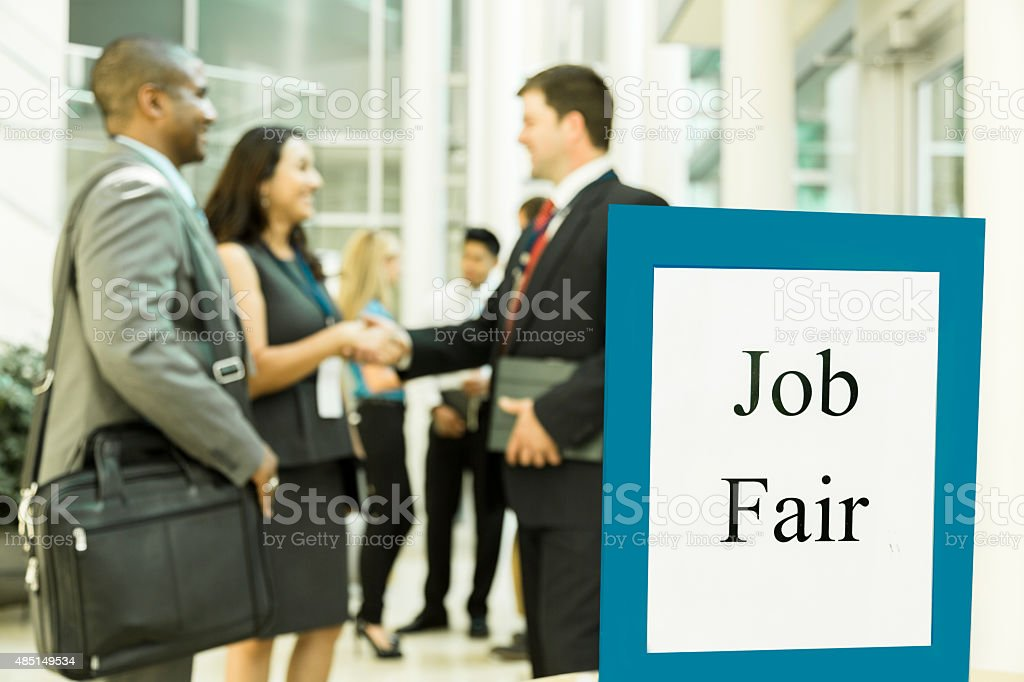 Business: Unemployed professionals attend a local job fair. stock photo